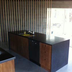 KItchen, island, timber and black stone